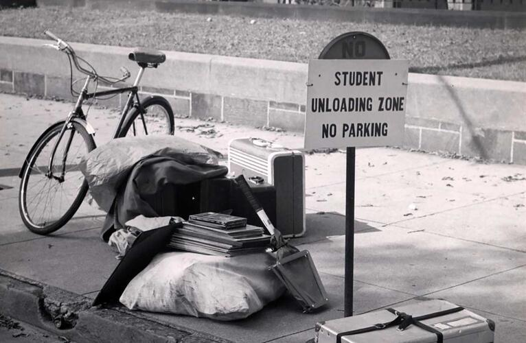 Books, suitcases and bicycle by the curb during Freshman week, 1954.